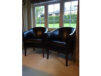 2 Dark leather tube chairs