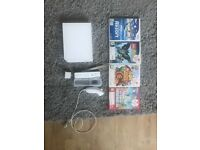 Nintendo Wii, 1 controller + nunchuck and 4 games