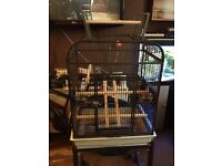 Medium sized bird cage with stand on wheels