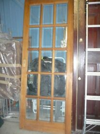Solid wood interior door with 15 bevelled glass panes