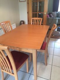Table and four dining chairs in good condition - chairs have been recently reupholstered