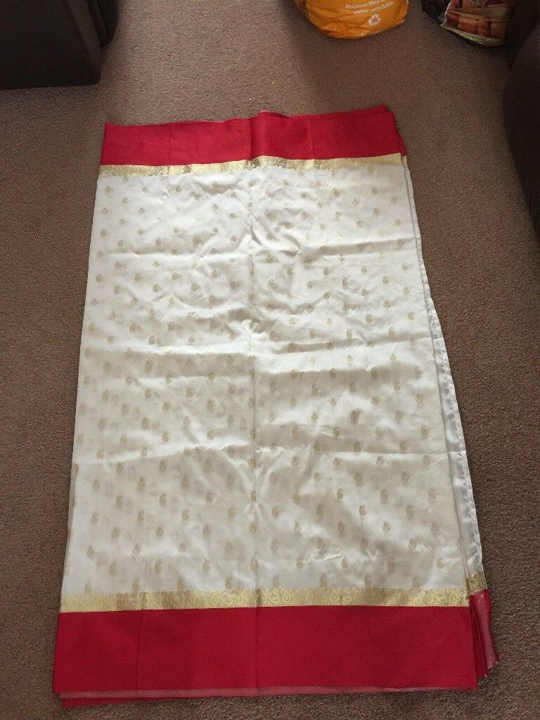 Simple white, gold and red saree