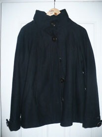 Ladies short black coat/jacket size L from Zara. Very good condition. Hardly worn.