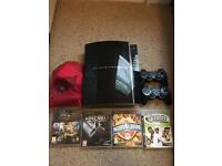 PS3 with 2 controllers & 5 games (inc Buzz)