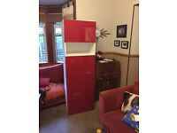Tall ikea besta unit with red gloss doors