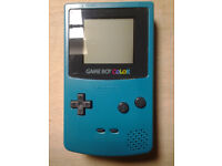 game boy colour with 2 games