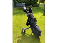 Set of golf clubs and trolley