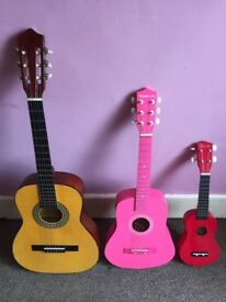 Adult and child guitars and a ukeliely
