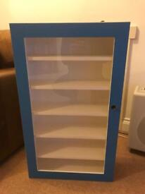 Blue wooden display unit with perspex glass front.