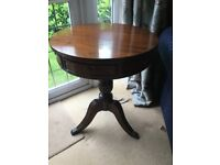 Dark wood round side table with drawers. Excellent condition.