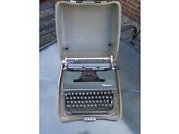 Olympia vintage portable type writer