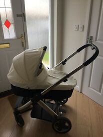 Cream oyster pram comes with parasol and rain cover