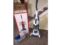 Brand new upright vacuum and car vacuum