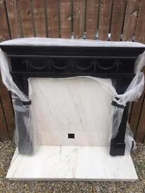 Solid marble fireplace with wooden surround