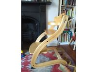 lovely wooden high chair with adjustable seat height (grows with your child)