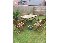 Wood garden table and six chairs. The table requires bolts as the original ones are missing.