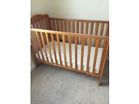 Cot and chest of drawers, matching set.