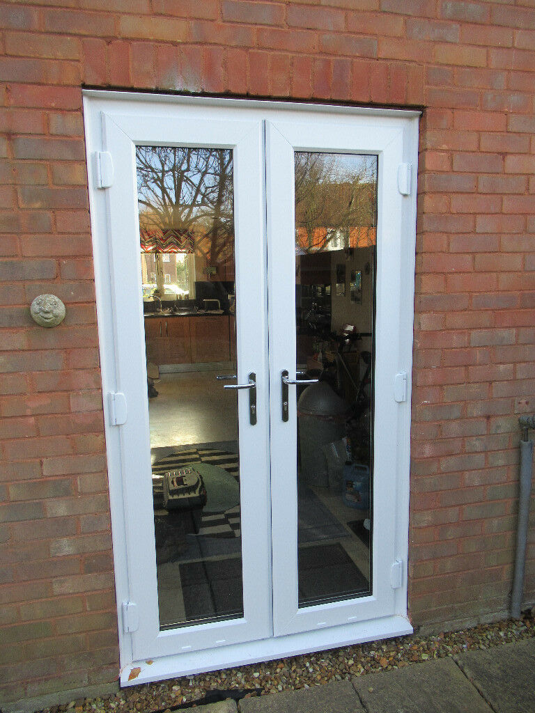 white upvc french doors with low aluminum threshold