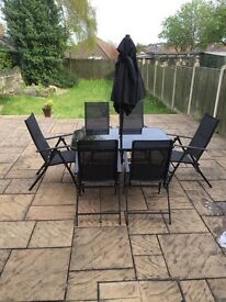 Garden table, chairs and umberella