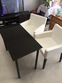 Glass top table with armchairs