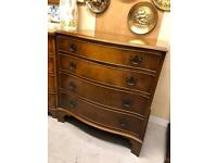 Walnut serpentine fronted chest of drawers