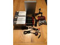 PlayStation 2 with 17 Games inc Buzz & Controllers
