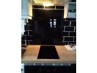 Kitchen glass hob splashback
