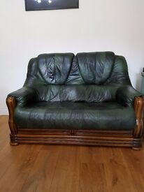 Green real leather 2 seater sofa in good condition