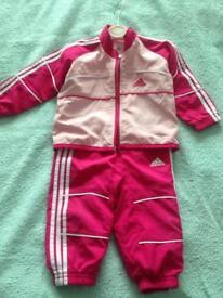 Child's pink adidas tracksuit