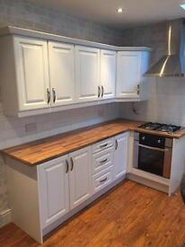 Kitchen doors and drawers with hinges