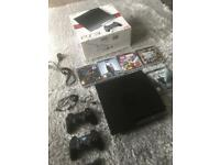 PS3 with original packaging, 2 controls, 5 games