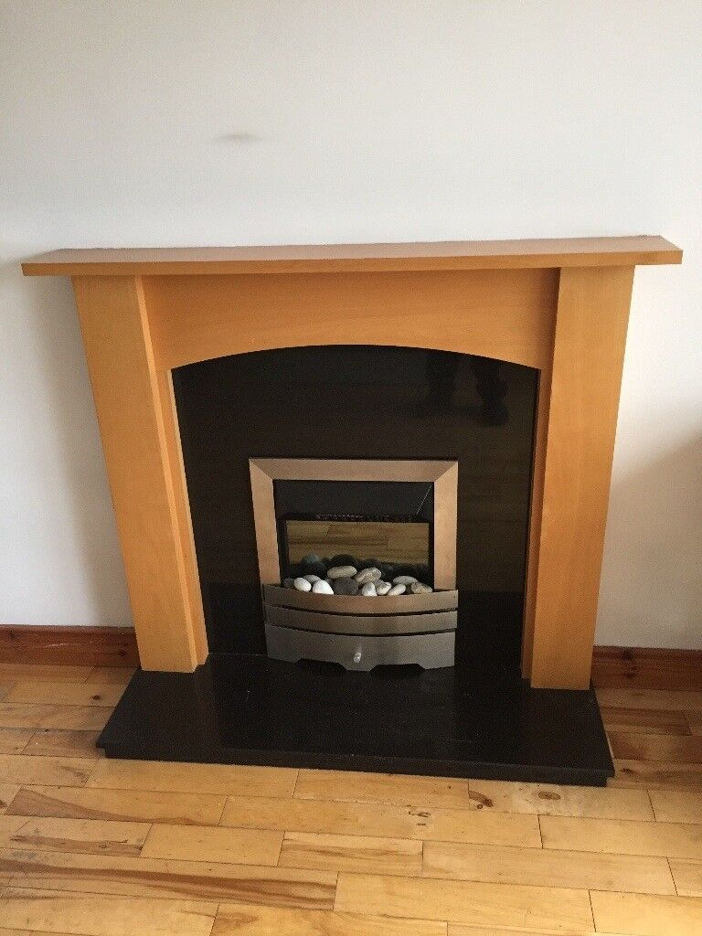 granite fireplace, surround and electric fire