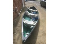 15' three seater canoe two paddles and two buoyancy aids