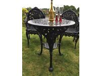 Stunning cast iron table & chairs