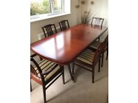 Stag mahogany dining room suite (extending table, four chairs, two carver chairs)