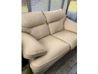 Two seater cream leather sofa, ex-Fishpools