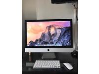 Apple IMac computer with keyboard and mouse