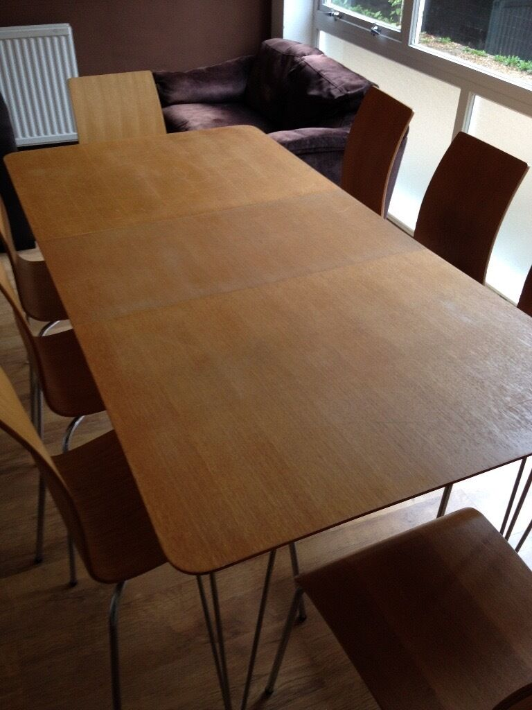 Dining table with oak finishin Ipswich, SuffolkGumtree - Dining table with 8 chairs all oak & chrome finish. Originally from Homebase. Table measures approx 80 cm wide and 140 cm long or 180 cm long with extension panel. Table has some marks (as shown in photos). Chairs in very good condition