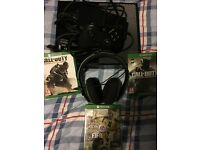 Xbox one with one controller , head set and 3 games