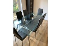 Cargo Home Glass Top Dining table and 6 chairs
