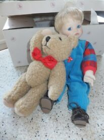 Cody and cuddle bear .Porcelain doll