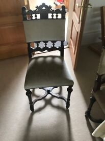 12 dining chairs ( 2 with slight damage) dark wood with light upholstery.