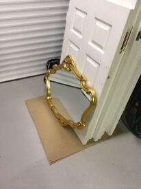 Regency ornate gold frame mirror.