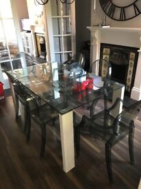 Glass dining table and 6 ghost chairs