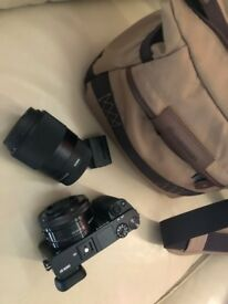 Newly bought Sony A6000 Camera with Sigma 33B965 30mm F1.4 DC DC Sony E-mount black and camera bag
