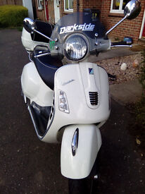 Vespa scooter with 2 helmets, jacket, gloves, trousers