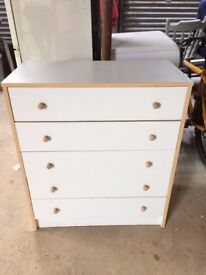 White chest of drawers with wooden handles