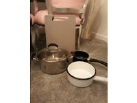 Pots and pans x3 plus a grey chopping board