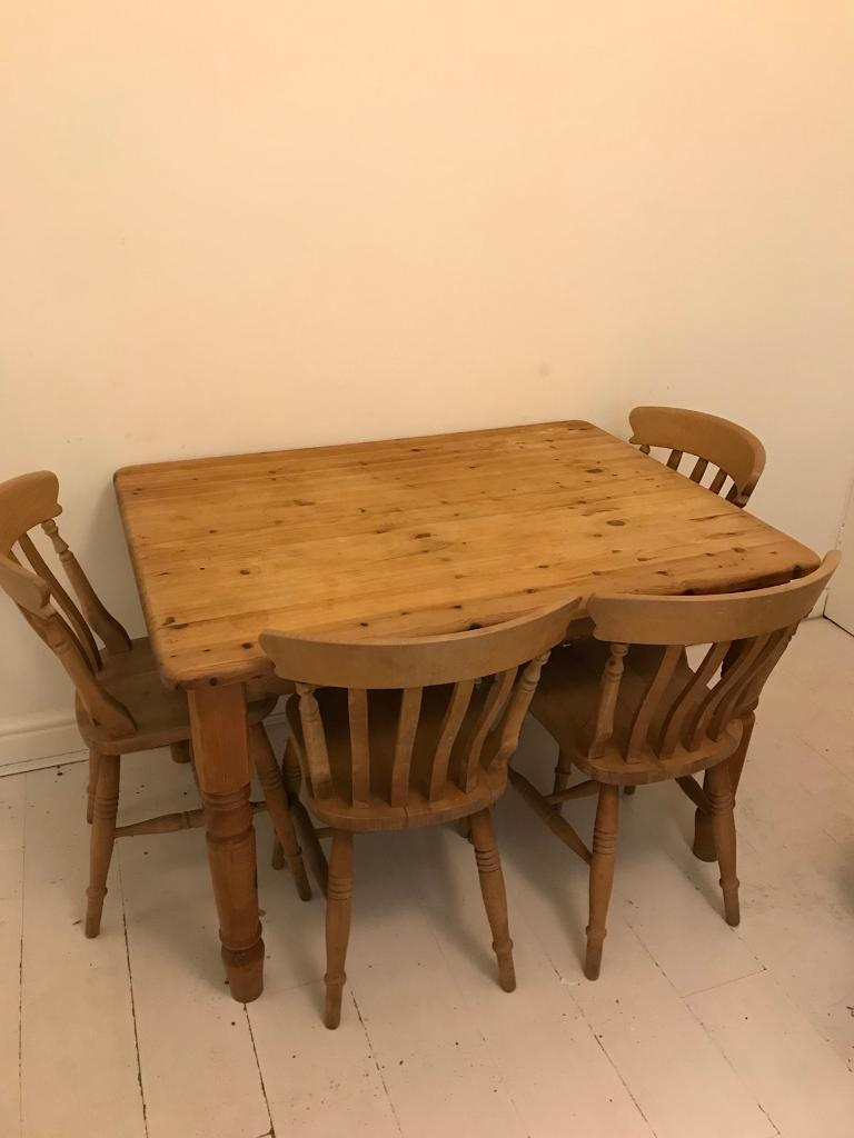 Lovely pine dining table and 4 chairs