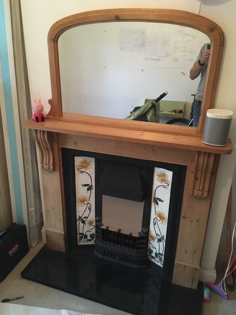 Cast iron fire and tile fire with wooden surround